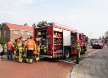 Brand in wasemkap: bewoonster naar ziekenhuis
